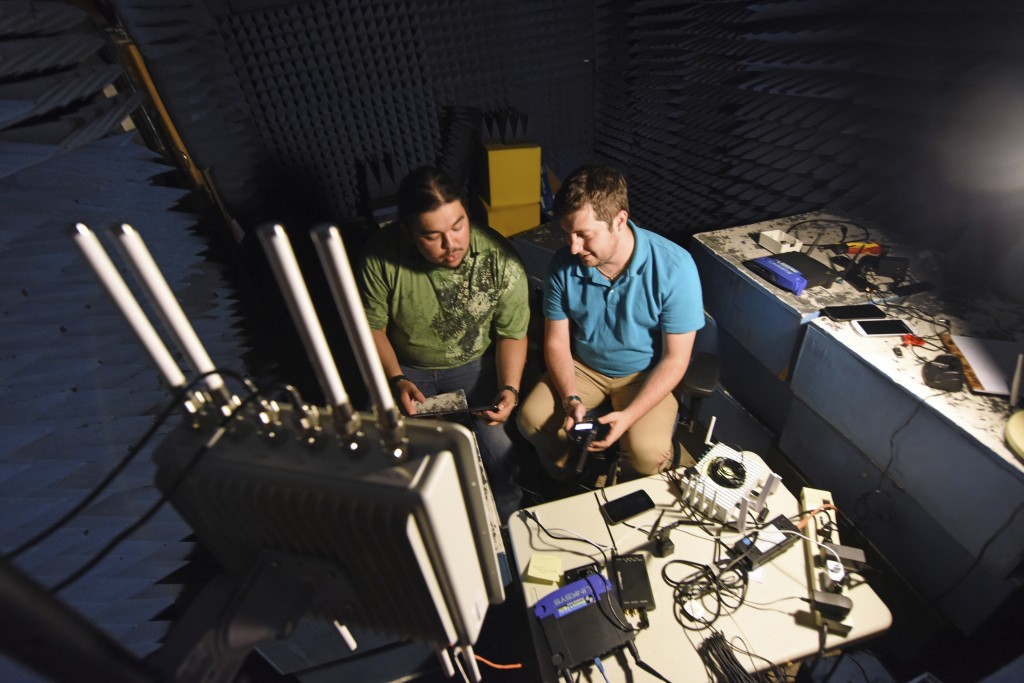 In this September 2018 photo provided by the Idaho National Laboratory, INL interns Armando Juarez Jr., left, and Jordan Mussman work in the Faraday r...