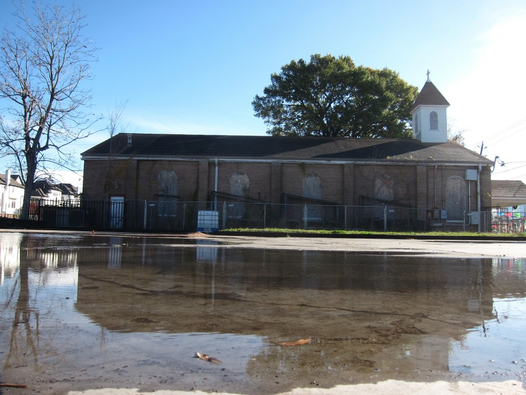 In this Dec. 20, 2018 photo a chain link fence surrounds St. Stephen Catholic Church in Houston, Texas, which has been closed since May 2016 by order ...