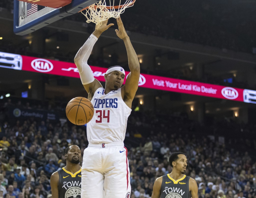 Los Angeles Clippers forward Tobias Harris (34) dunks the ball against the Golden State Warriors in the second quarter of an NBA basketball game, Sund