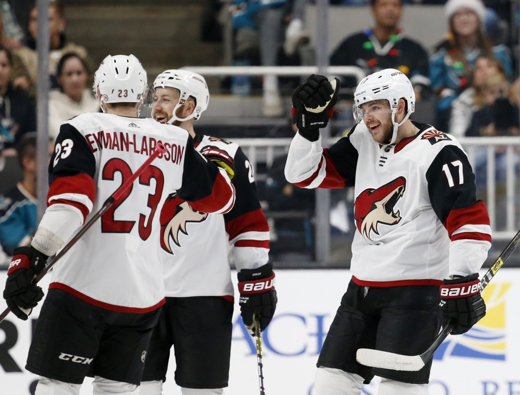 Arizona Coyotes' Alex Galchenyuk (17) celebrates with Oliver Ekman-Larsson (23) after scoring his second goal of the night against the San Jose Sharks...