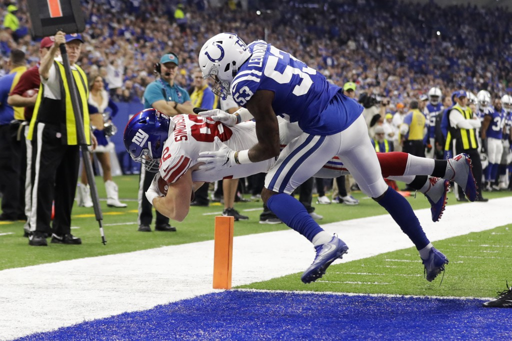 New York Giants tight end Scott Simonson (82) dives in for a touchdown under Indianapolis Colts outside linebacker Darius Leonard (53) during the firs...