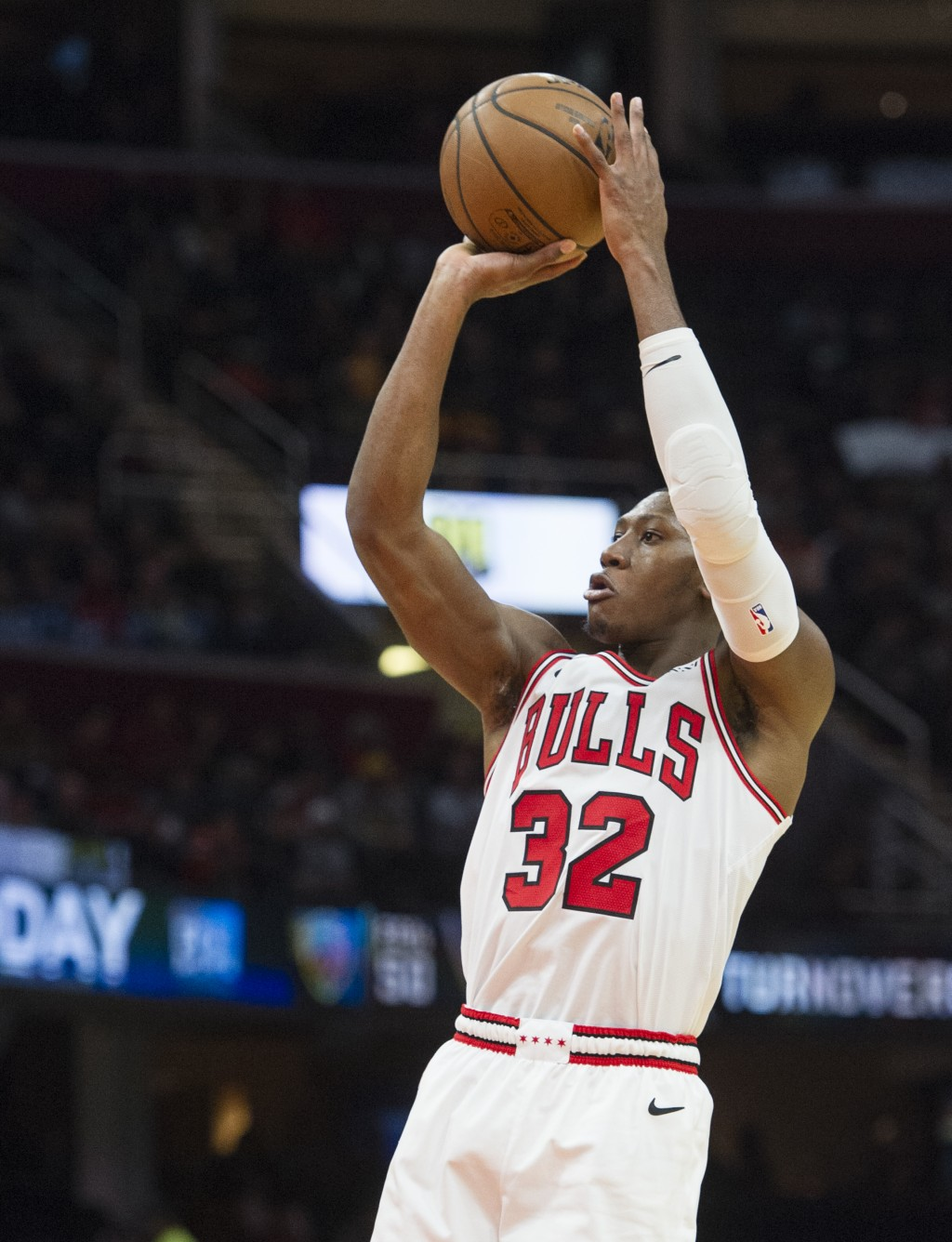 Chicago Bulls' Kris Dunn (32) shoots against the Cleveland Cavaliers during the first half of an NBA basketball game in Cleveland, Sunday, Dec. 23, 20
