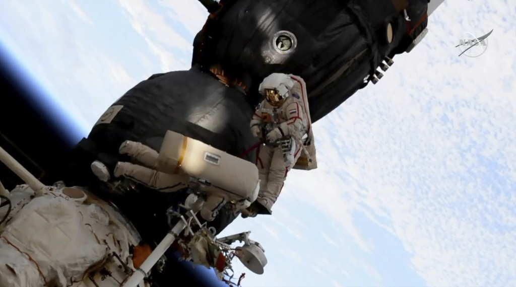 FILE - In this Tuesday, Dec. 11, 2018 file image from video made available by NASA, Russian cosmonaut Oleg Kononenko, right, and Sergei Prokopyev perf...