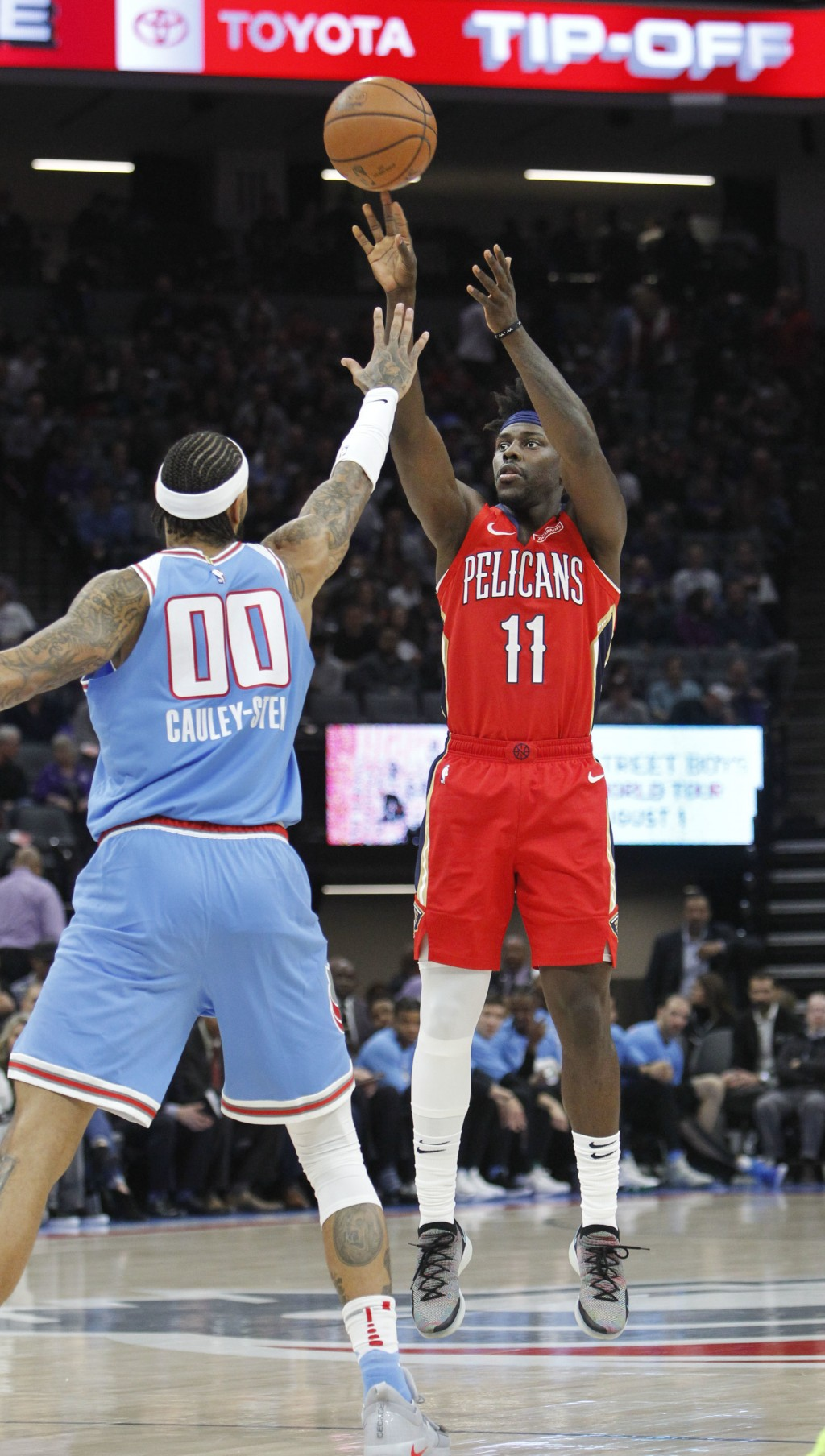 New Orleans Pelicans guard Jrue Holiday (11) shoots over Sacramento Kings center Willie Cauley-Stein (00) during the first half of an NBA basketball g...