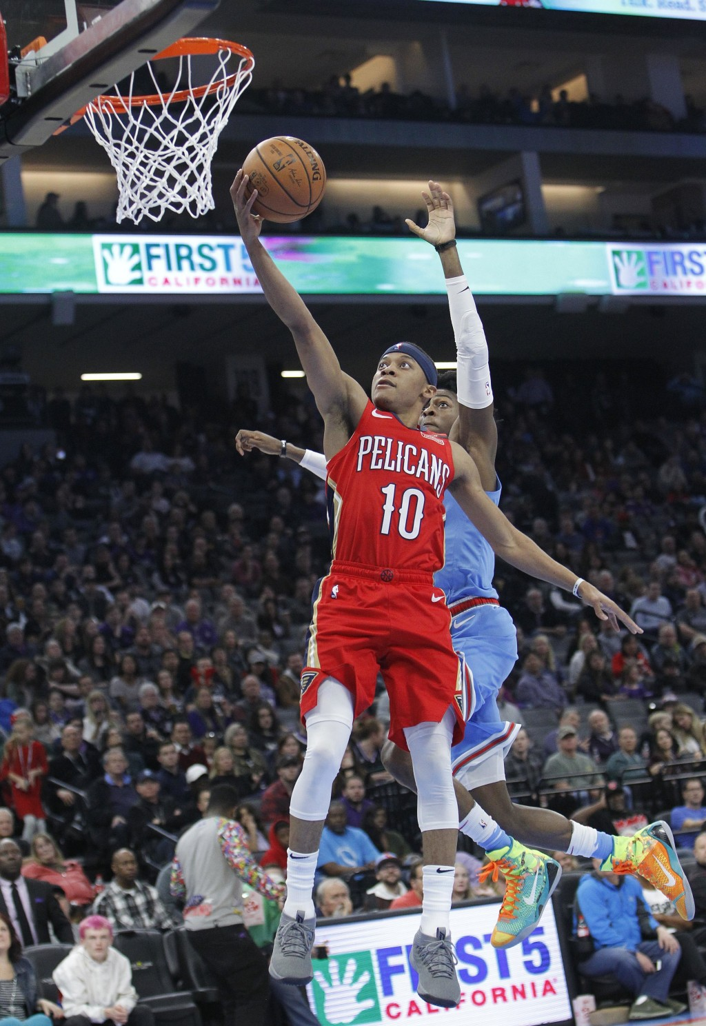 New Orleans Pelicans guard Tim Frazier (10) drives to the basket only to have his shot blocked by Sacramento Kings guard De'Aaron Fox (5) during the f...