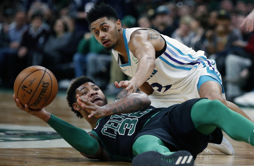 Boston Celtics' Marcus Smart (36) and Charlotte Hornets' Jeremy Lamb (3) battle for the ball during the second half of an NBA basketball game in Bosto...