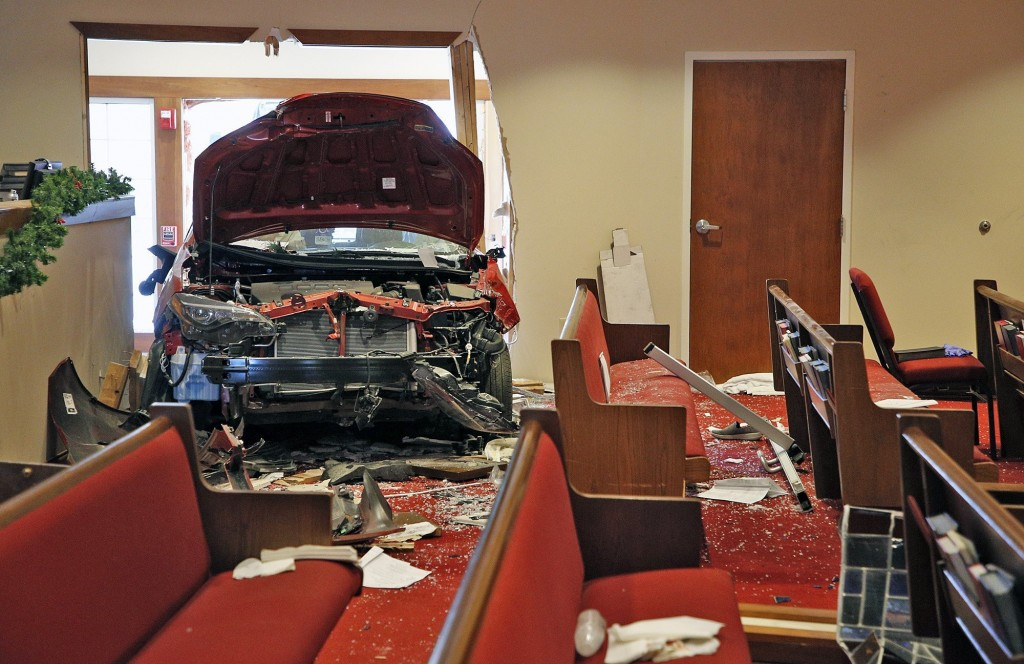 A car that crashed into the entrance of the Crossroads United Methodist Church located at 1100 Hague Avenue is visible from inside of the church on th...