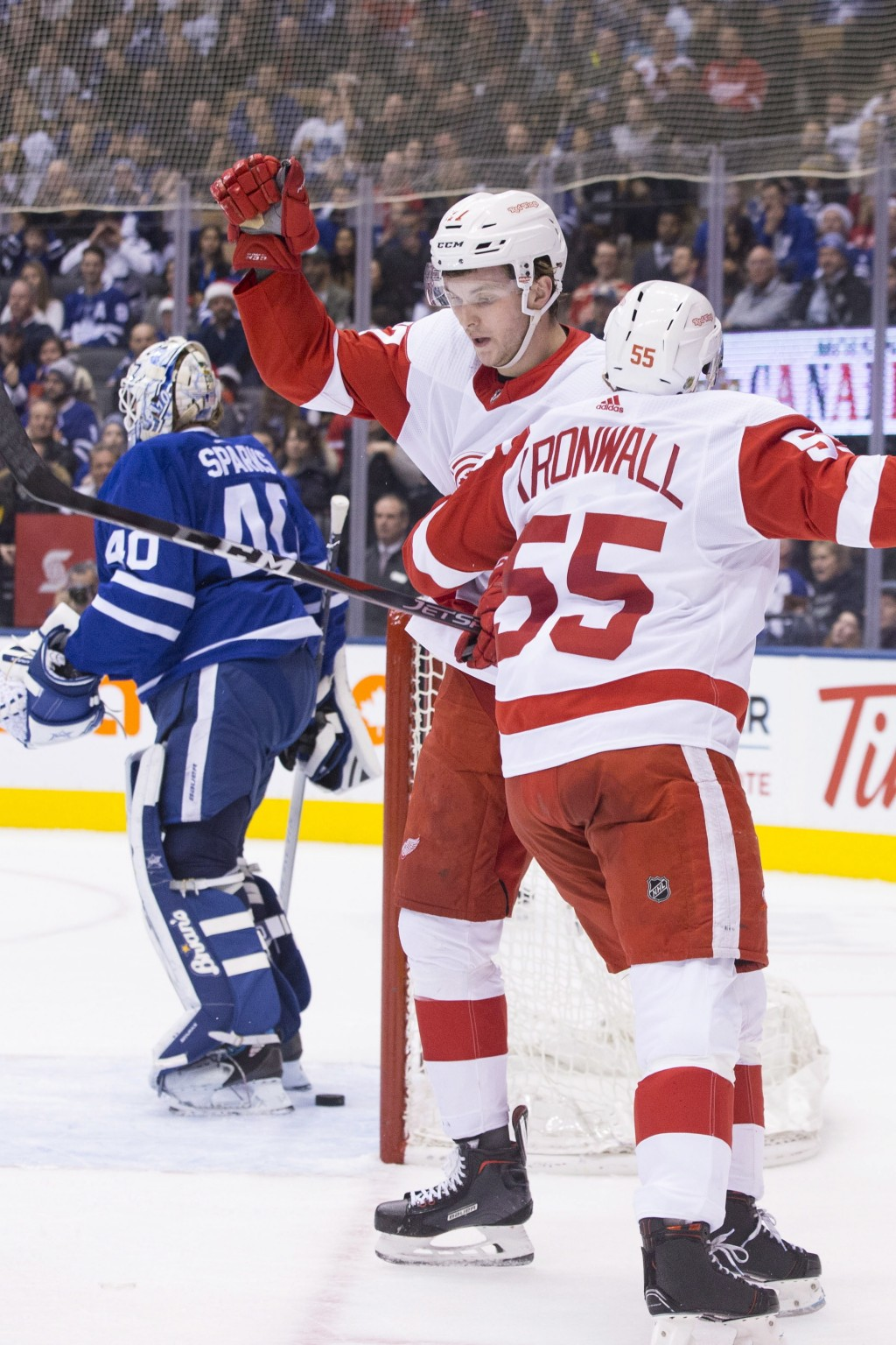 Detroit Red Wings Michael Rasmussen, center, is congratulated by Niklas Kronwall after scoring his team's second goal oagainst Toronto Maple Leafs goa...