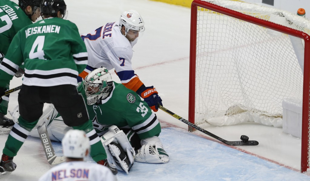 New York Islanders right wing Jordan Eberle (7) scores a goal against Dallas Stars goaltender Anton Khudobin (35), Miro Heiskanen (4) and Taylor Fedun...
