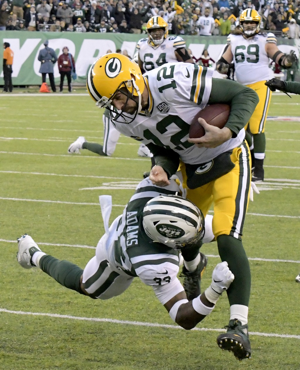 Green Bay Packers quarterback Aaron Rodgers (12) is tackled by New York Jets strong safety Jamal Adams (33) during the second half of an NFL football ...