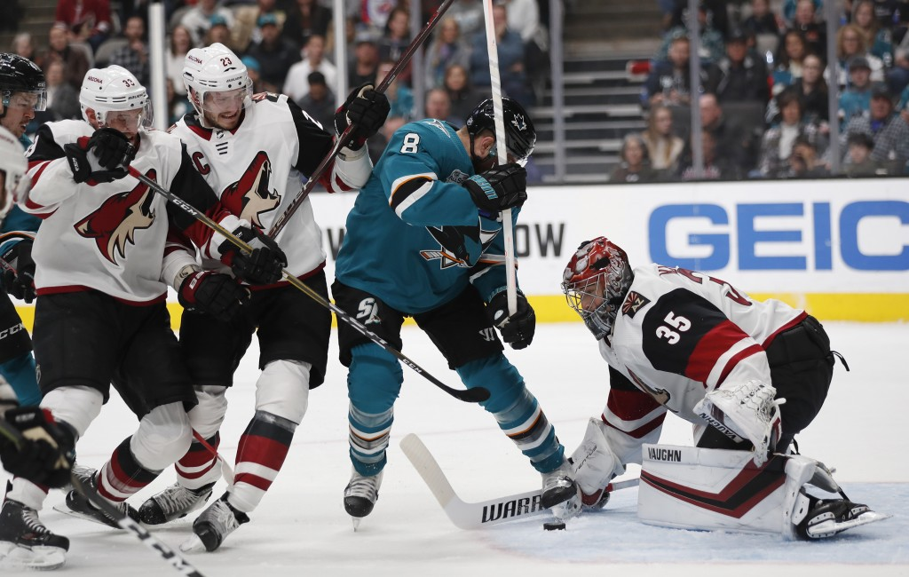 San Jose Sharks' Joe Pavelski (8) battles for the puck against Arizona Coyotes' Darcy Kuemper (35), Alex Goligoski (33) and Oliver Ekman-Larsson (23) ...