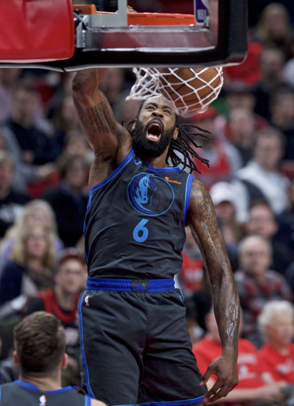 Dallas Mavericks center DeAndre Jordan dunks against the Portland Trail Blazers during the first half of an NBA basketball game in Portland, Ore., Sun...