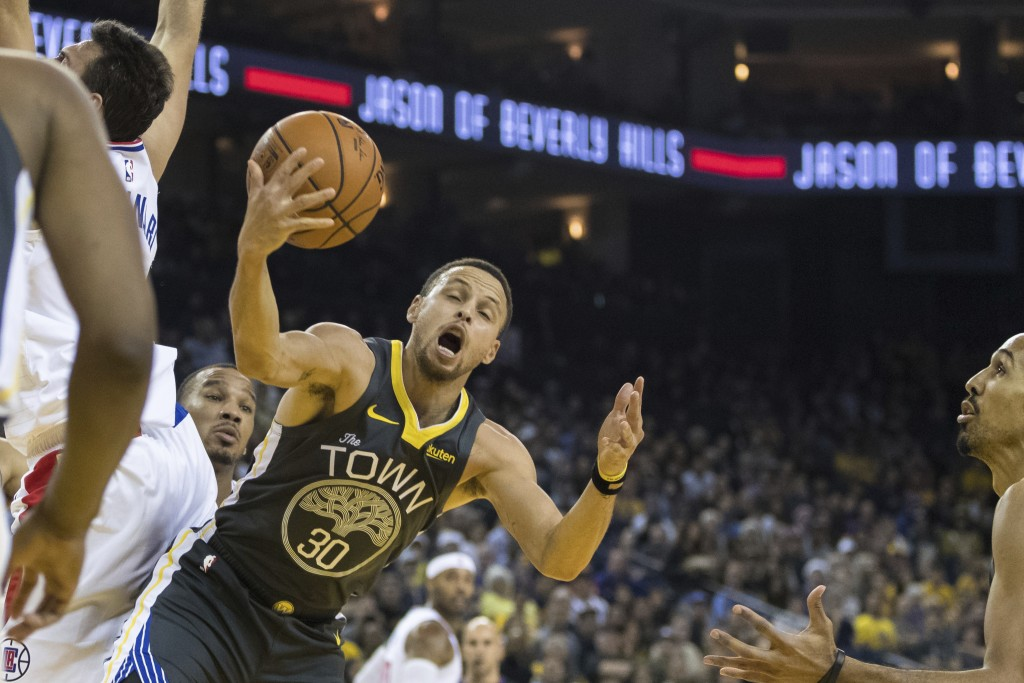 Golden State Warriors guard Stephen Curry (30) gets a rebound against the Los Angeles Clippers in the second quarter of an NBA basketball game, Sunday...