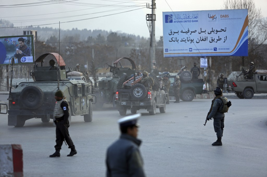 Afghan security forces arrive at the site of an explosion and attack by gunmen, in Kabul, Afghanistan, Monday, Dec. 24, 2018. (AP Photo/Rahmat Gul)