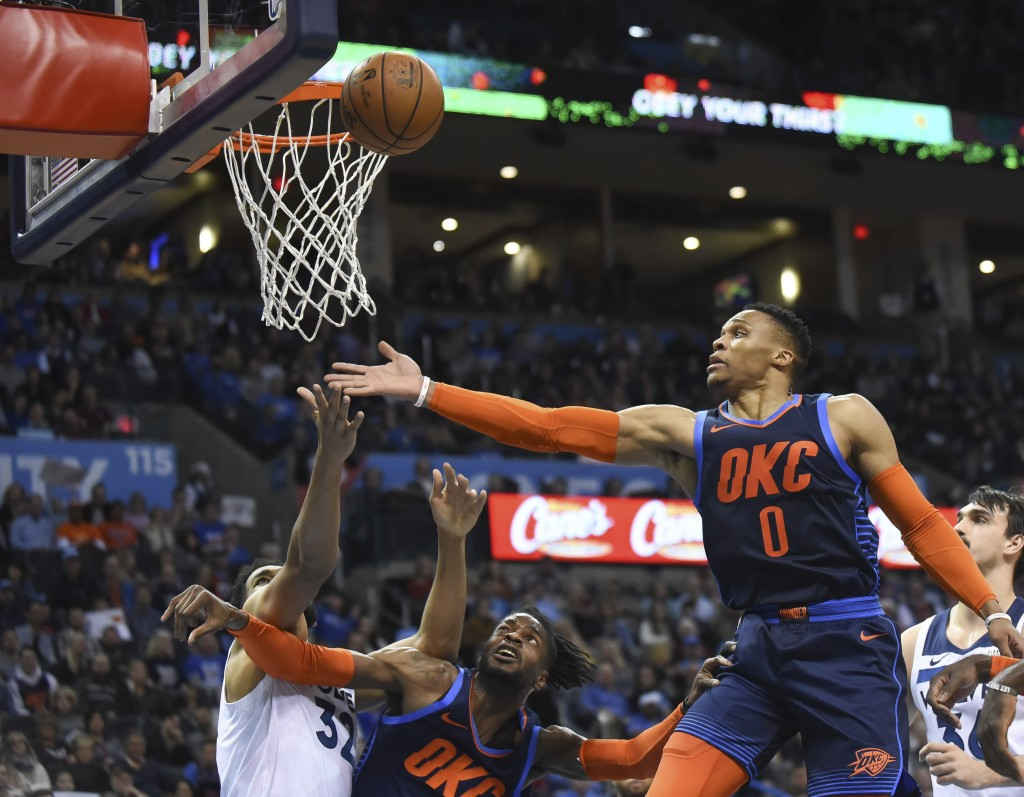 Oklahoma City Thunder forward Nerlens Noel (3) tries to hold back Minnesota Timberwolves center Karl-Anthony Towns as Thunder guard Russell Westbrook