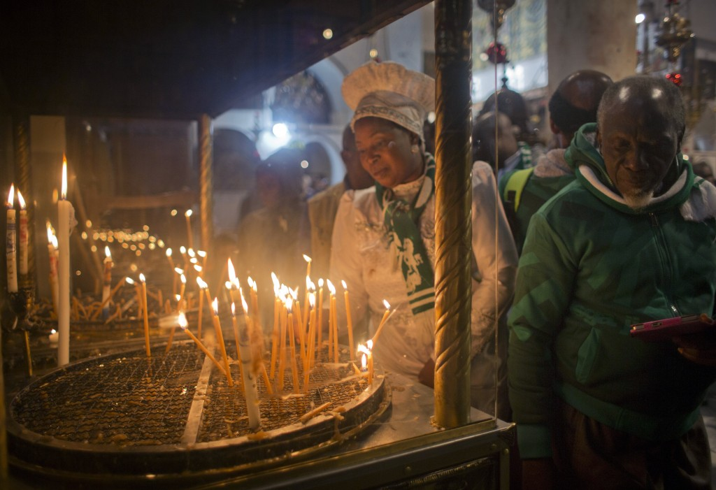 Christian worshippers light candles at the Church of the Nativity, traditionally recognized by Christians to be the birthplace of Jesus Christ, in the...