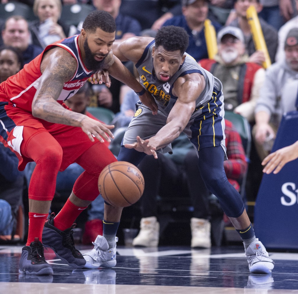 Washington Wizards forward Markieff Morris (5), left, and Indiana Pacers forward Thaddeus Young (21) battle for the ball during the second half of an ...