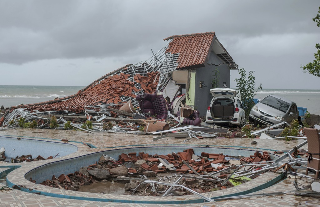 In this Sunday, Dec. 23, 2018, photo, debris littered a property badly damaged by a tsunami in Carita, Indonesia. The tsunami that hit the coasts of I...