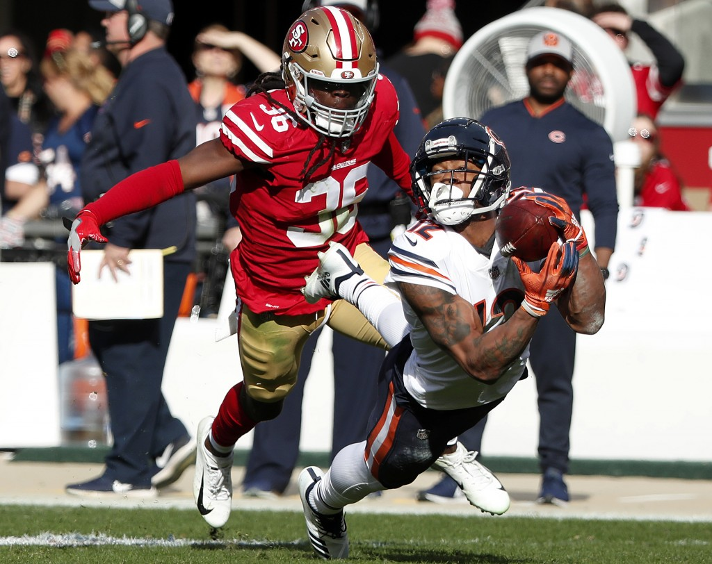 Chicago Bears wide receiver Allen Robinson II, right, catches a pass in front of San Francisco 49ers defensive back Marcell Harris during the first ha...