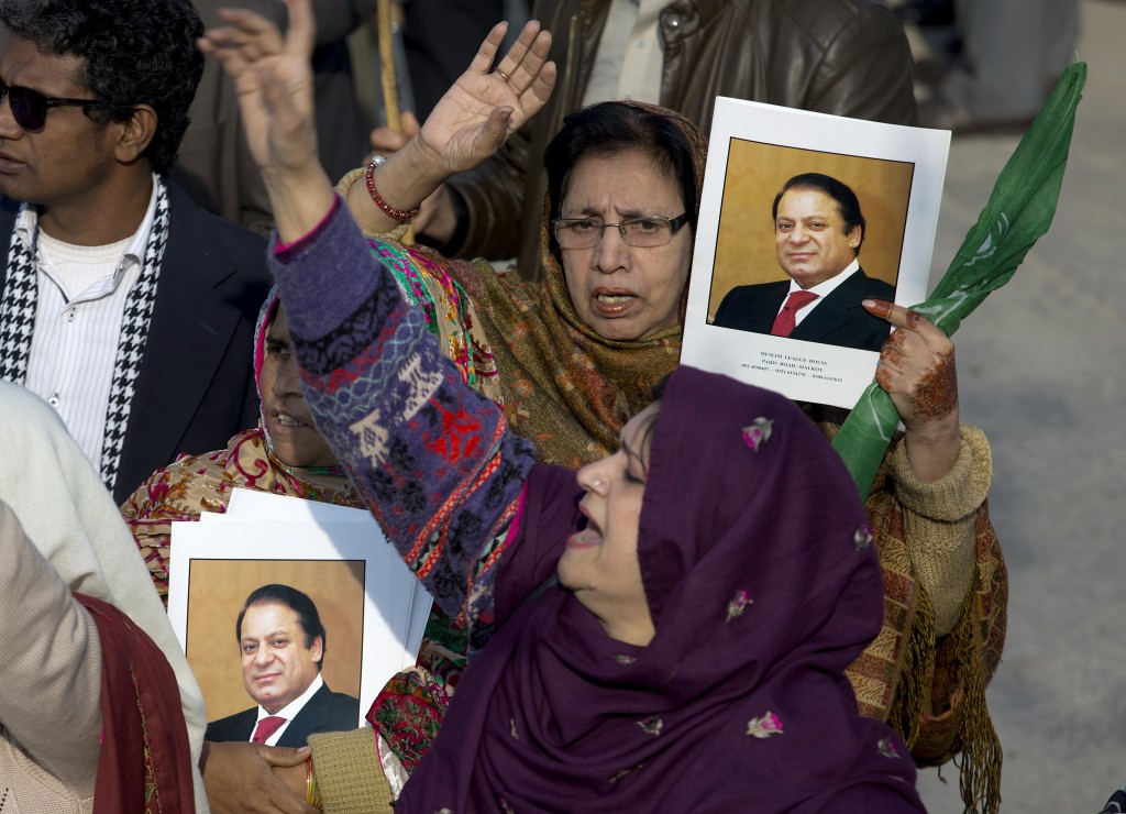 Supporters of former Pakistani Prime Minister Nawaz Sharif shout slogans against the government outside an accountability court in Islamabad, Pakistan...