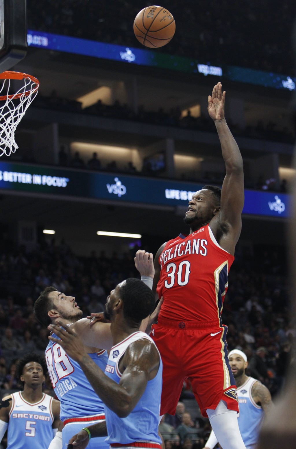 New Orleans Pelicans forward Julius Randle (30) shoots over Sacramento Kings forward Nemanja Bjelica (88) during the first half of an NBA basketball g...