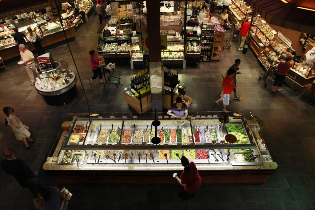 FILE - In this May 27, 2010, file photo, customers shop at the salad bar for lunch at the Market Cafe in the Wegmans grocery store in Fairfax, Va. The...