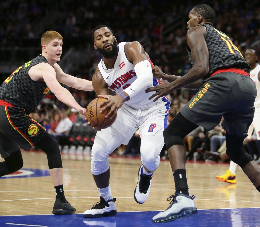 Detroit Pistons center Andre Drummond, center, drives to the basket against Atlanta Hawks guard Kevin Huerter, left, and Atlanta Hawks center Dewayne ...