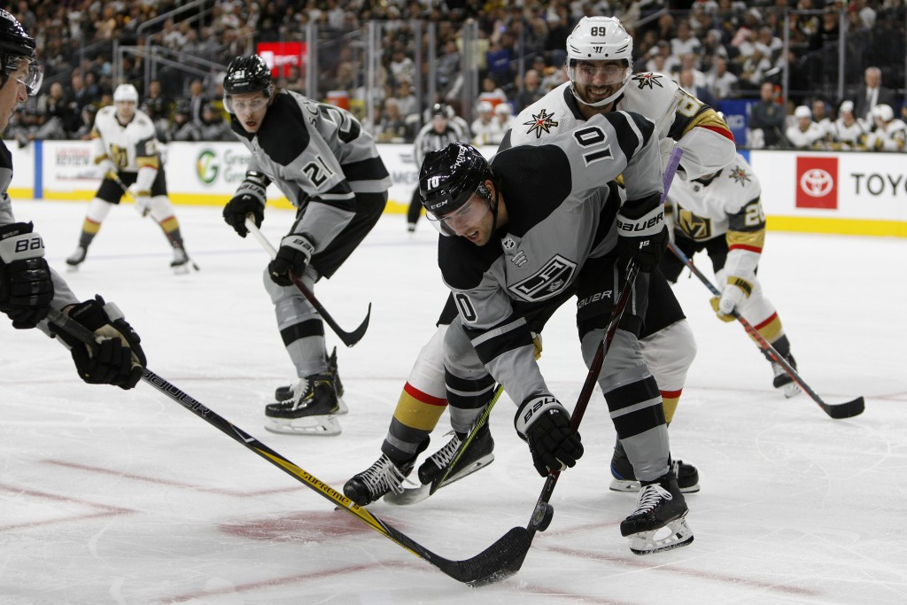 Los Angeles Kings center Michael Amadio (10) and Vegas Golden Knights right wing Alex Tuch (89) battle for the puck during the second period of an NHL...