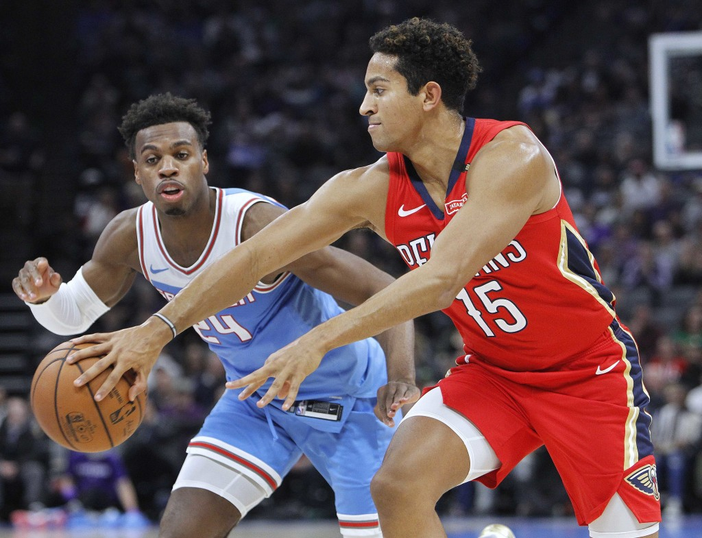 New Orleans Pelicans guard Frank Jackson (15) passes the ball around Sacramento Kings guard Buddy Hield (24) during the first half of an NBA basketbal...