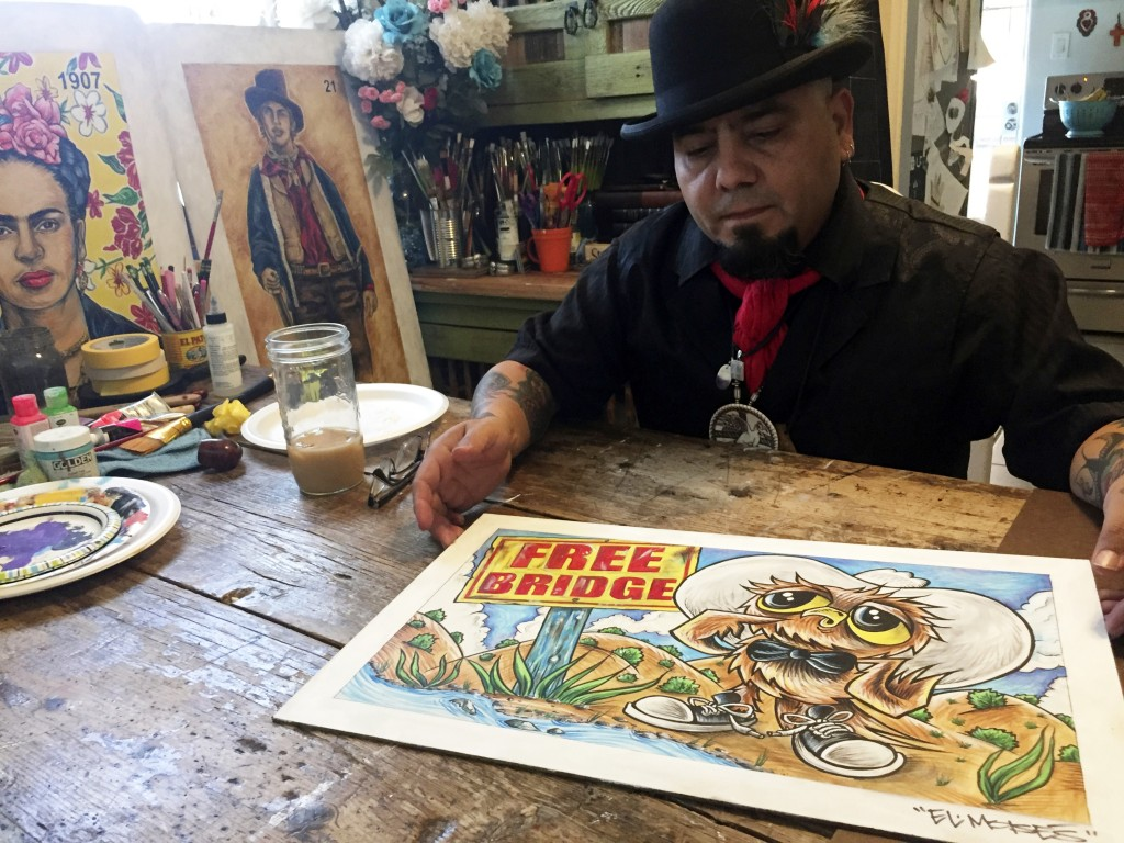 In this Thursday, April 5, 2018 photo artist Moises Salcedo of Albuquerque shows an early rendition of the lead character for the bilingual children's...