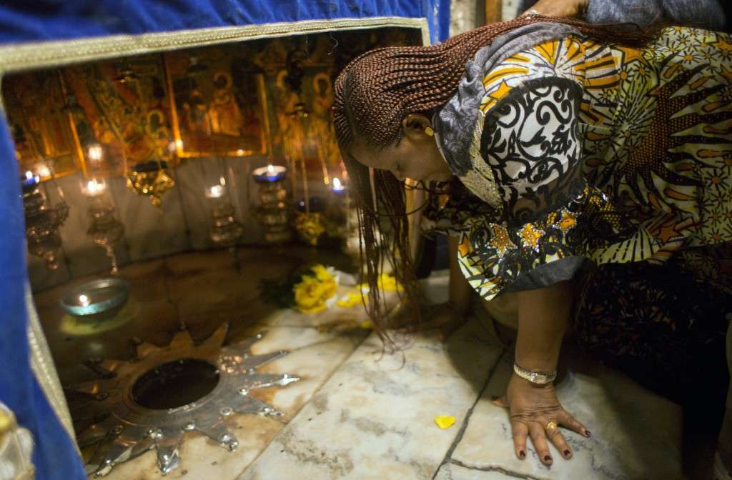 A Christian worshipper prays at the Grotto, under the Church of the Nativity, traditionally recognized by Christians to be the birthplace of Jesus Chr...
