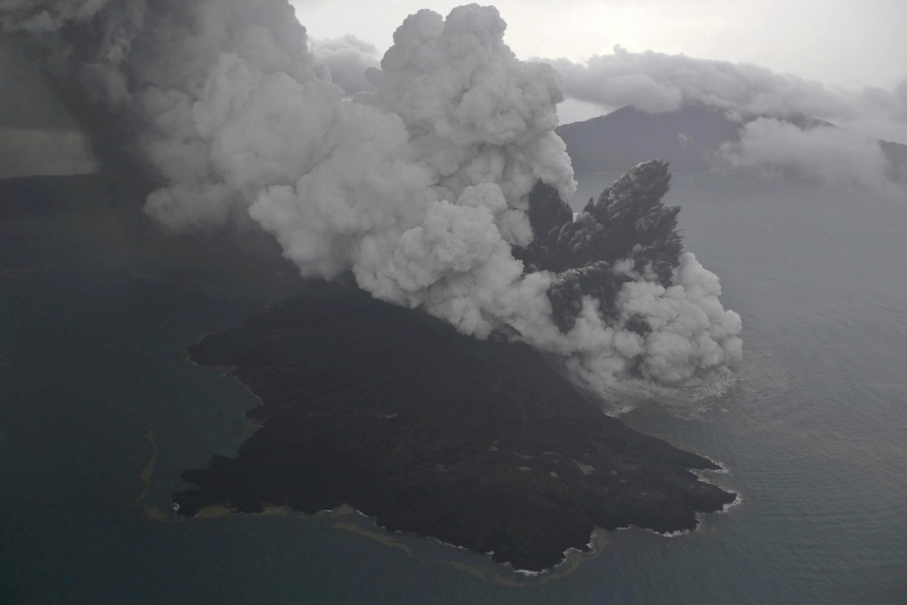 This aerial shot taken on Sunday, Dec. 23, 2018, shows Mount Anak Krakatau as it erupts on Java Strait, Indonesia. Doctors worked to save injured vict...