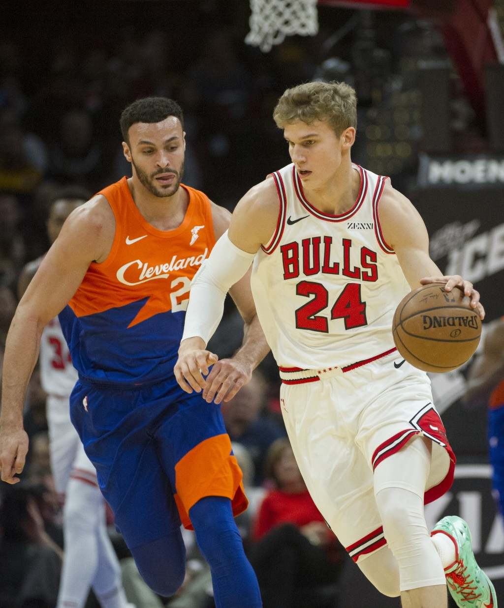 Chicago Bulls' Lauri Markkanen (24) drives around Cleveland Cavaliers' Larry Nance Jr. (22) during the first half of an NBA basketball game in Clevela