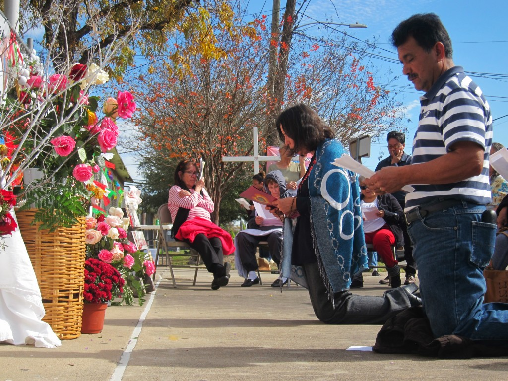 In this Dec. 16, 2018 photo, Rosario Rodriguez and Jose Guevara lead members of St. Stephen Catholic Church as they pray the rosary in front of a chai...