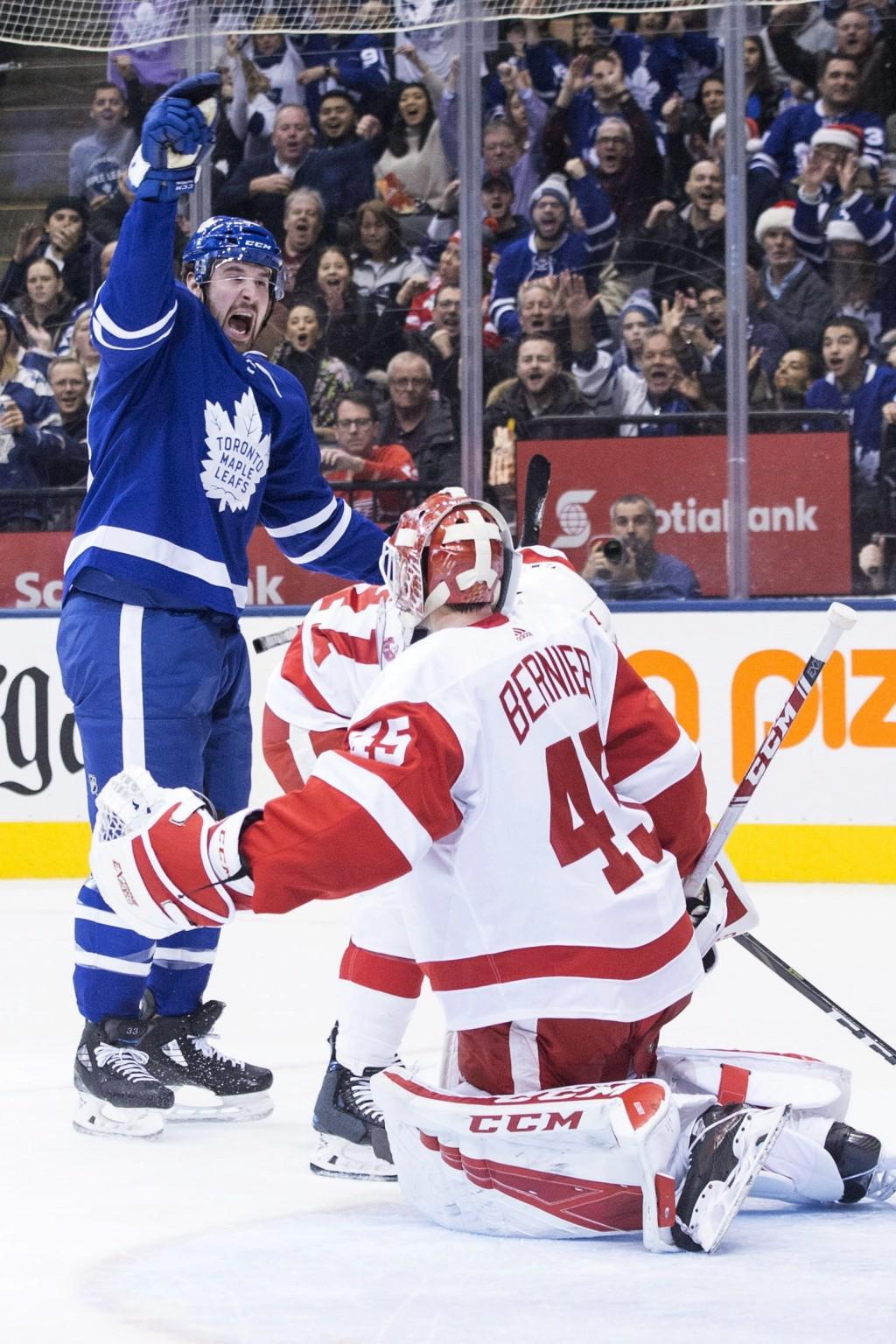 Toronto Maple Leafs Frederik Gauthier celebrates scoring a goal on Detroit Red Wings goaltender Jonathan Bernier during second period NHL hockey actio...