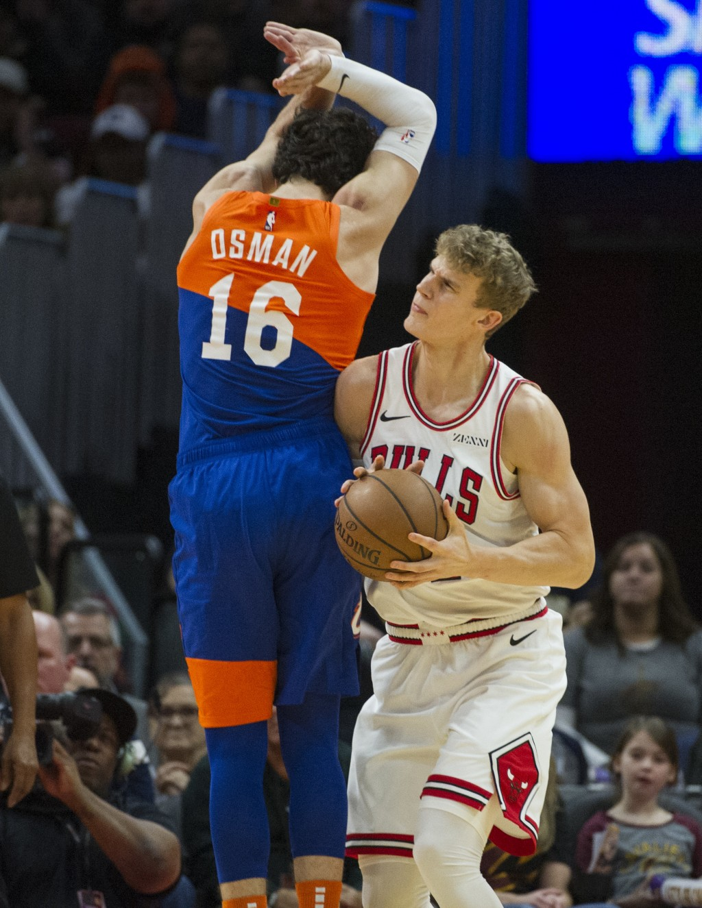 Chicago Bulls' Lauri Markkanen, right, moves past Cleveland Cavaliers' Cedi Osman, from Turkey, during the first half of an NBA basketball game in Cle