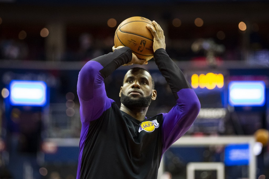 FILE - In this Dec. 16, 2018 file photo Los Angeles Lakers forward LeBron James (23) warms up before an NBA basketball game against the Washington Wiz...