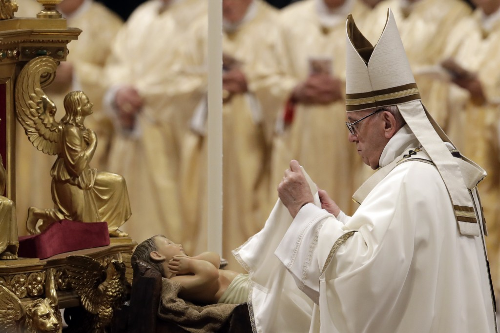 Pope Francis unveils a statue of Baby Jesus as he celebrates the Christmas Eve Mass in St. Peter's Basilica at the Vatican, Monday, Dec. 24, 2018. (AP...