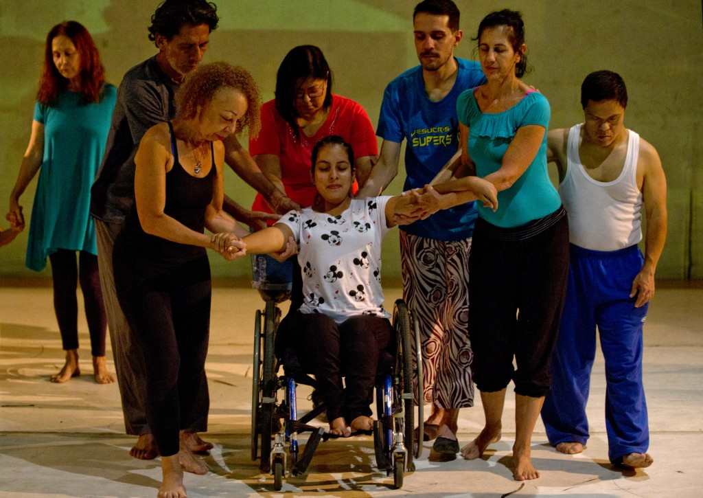 In this Dec. 4, 2018 photo, dancers practice prior to their last performance in the contemporary dance production Ubuntu, at the Teresa Carreno Theate...