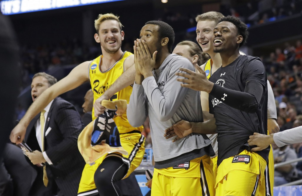 FILE - In this March 16, 2018, file photo, UMBC players celebrate a teammate's basket during the second half against Virginia i a first-round game in ...