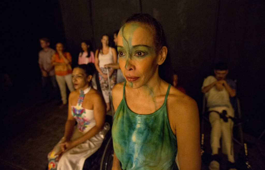 In this Dec. 4, 2018 photo, dancers watch their fellow dancers perform in the contemporary dance production Ubuntu, at the Teresa Carreno Theater in C...