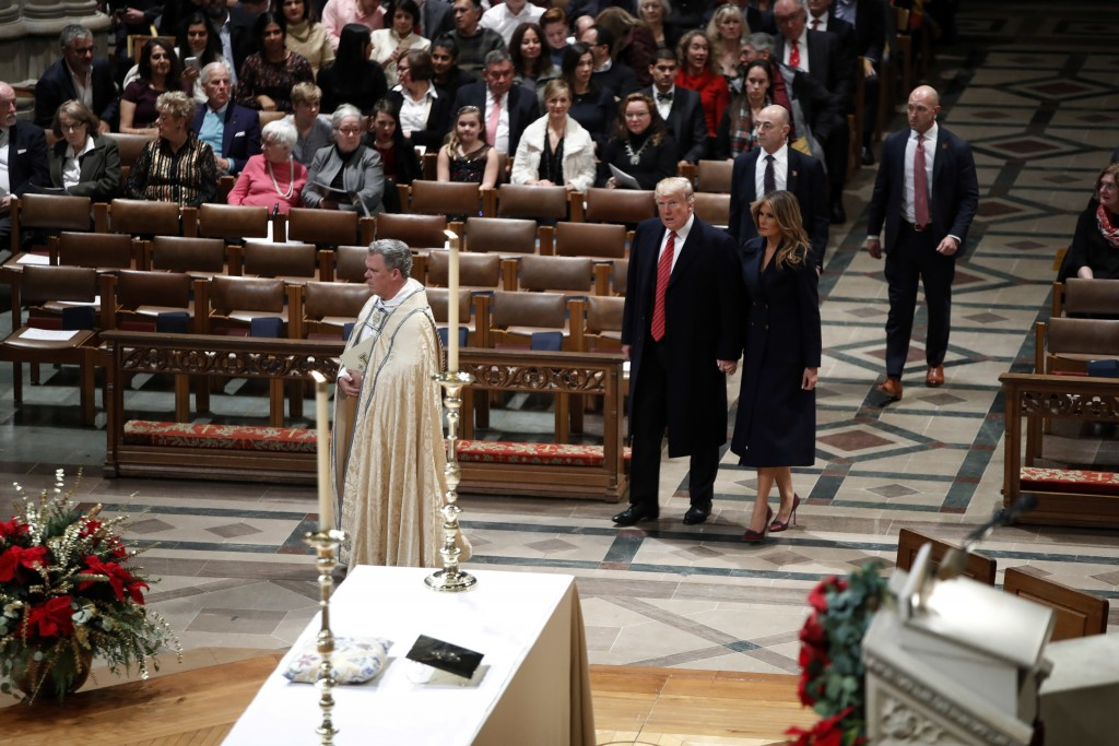 President Donald Trump and first lady Melania Trump arrive for a Christmas Eve service at the National Cathedral, Monday, Dec. 24, 2018, in Washington...