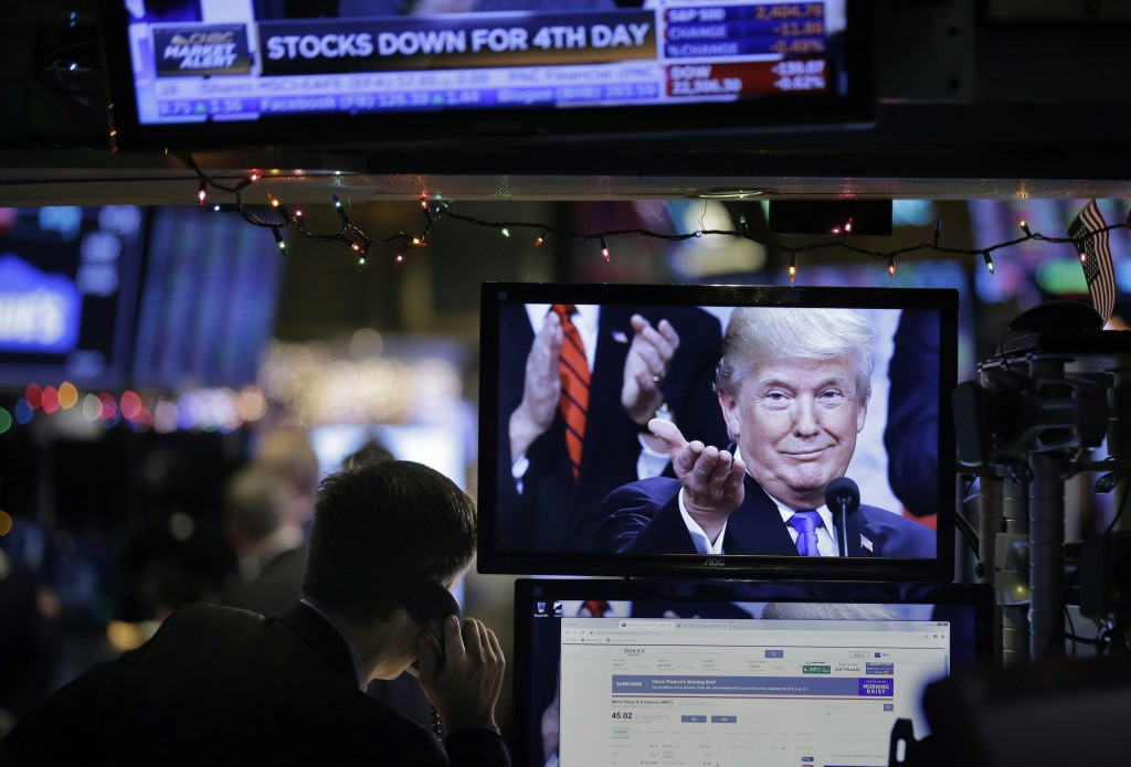 A picture of President Donald Trump is displayed on a computer on the floor of the New York Stock Exchange in New York, Monday, Dec. 24, 2018. (AP Pho...
