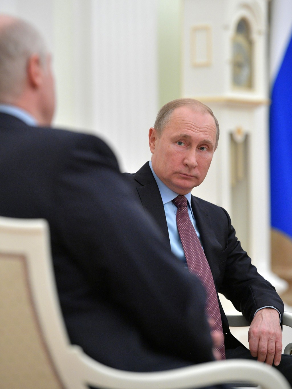 Russian President Vladimir Putin listens to his Belarusian counterpart Alexander Lukashenko, back to a camera, during their talks in the Kremlin in Mo...