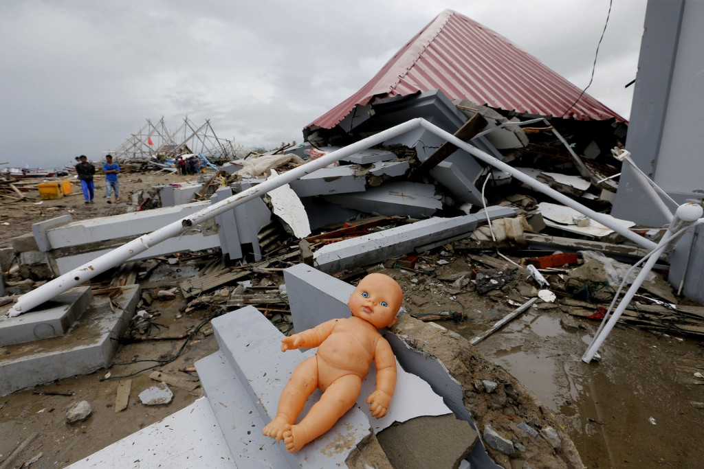 A doll lays outside a damaged house following the tsunami in Sumur, Indonesia, Tuesday, Dec. 25, 2018. The Christmas holiday was somber with prayers f...