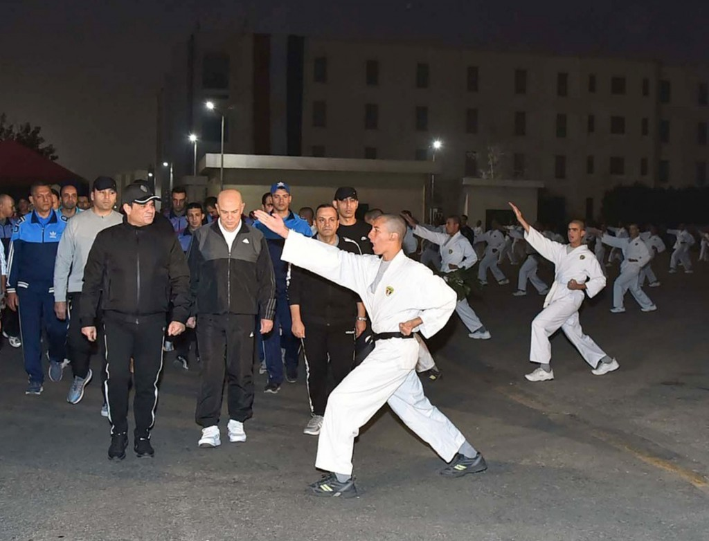 In this Dec. 16, 2018 photo released by the Egyptian Presidency, Egyptian President Abdel-Fattah el-Sissi inspects cadets during their morning exercis...