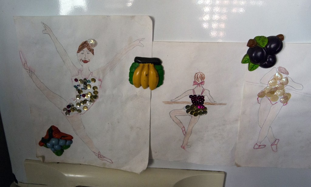 """In this Dec. 17, 2018 photo, drawings of dancers made by Iraly Yanez's niece decorates her fridge, in Caracas, Venezuela. """"Dancing is all about passio..."""