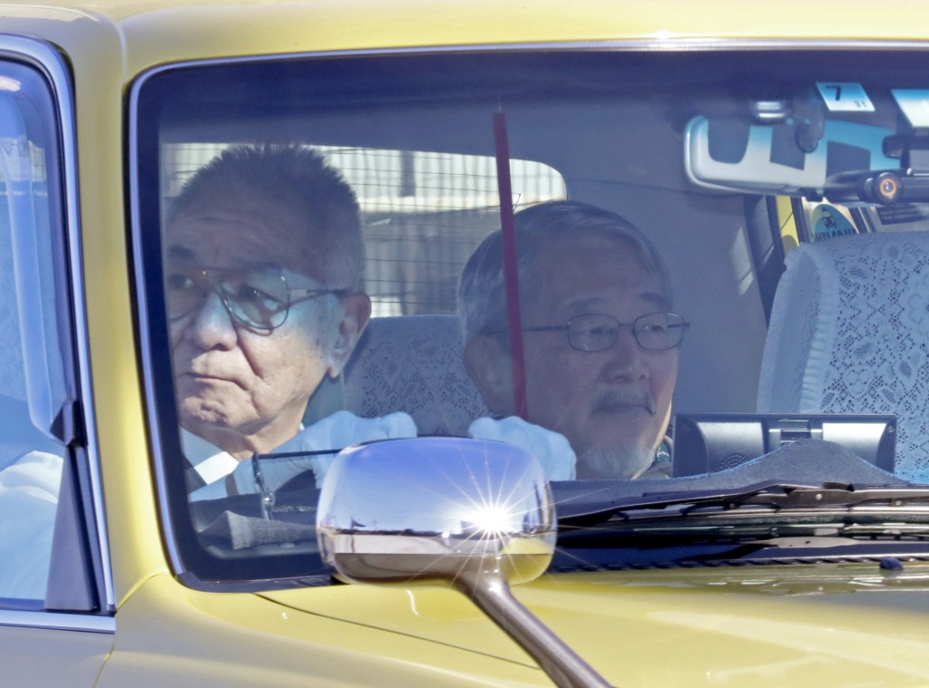 Yoichi Kitamura, right, a lawyer representing former Nissan executive Greg Kelly, leaves Tokyo Detention Center, where former Nissan chairman Carlos G...