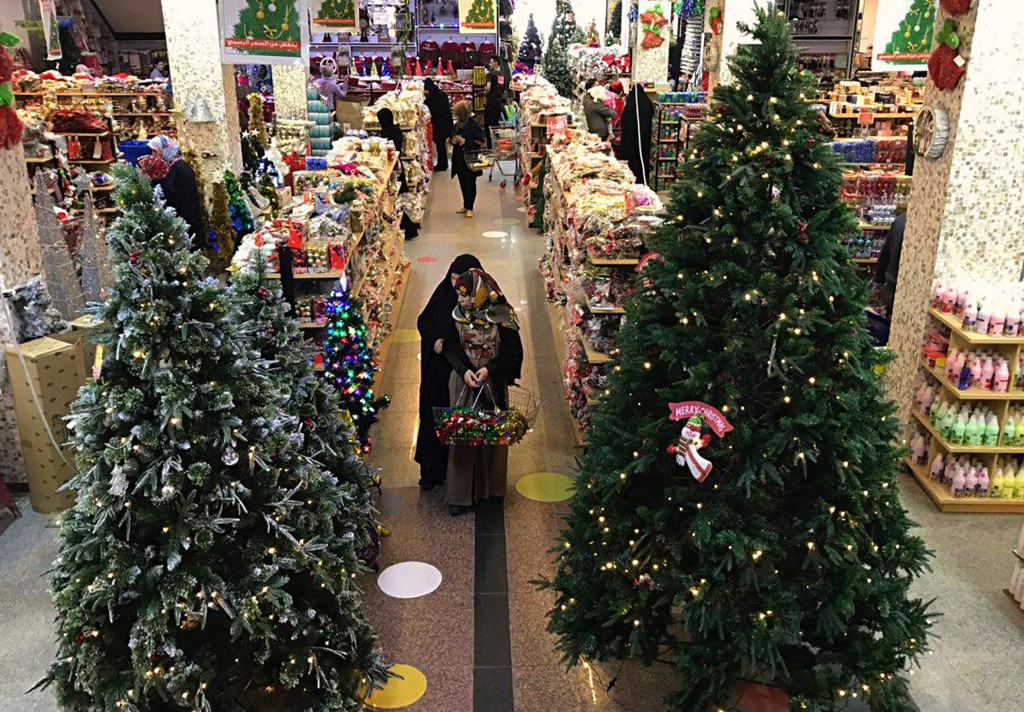 Iraqis shop for Christmas decorations in Baghdad, Iraq, Monday, Dec. 24, 2018. Although the number of Christians has dropped in Iraq, Christmas, a nat...