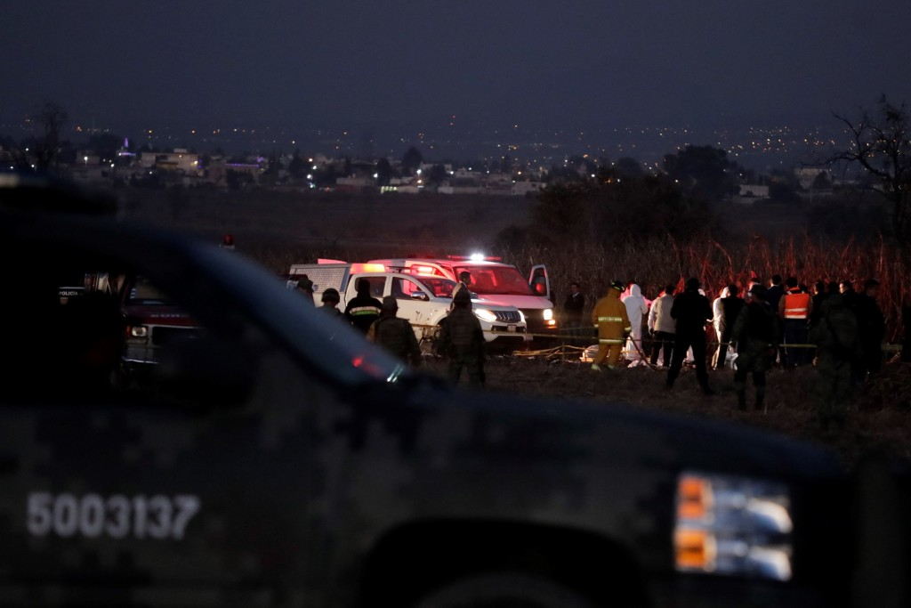 Emergency rescue personnel, the army and the police arrive to the scene of a helicopter crash where Puebla Gov. Martha Erika Alonso and her husband Ra...